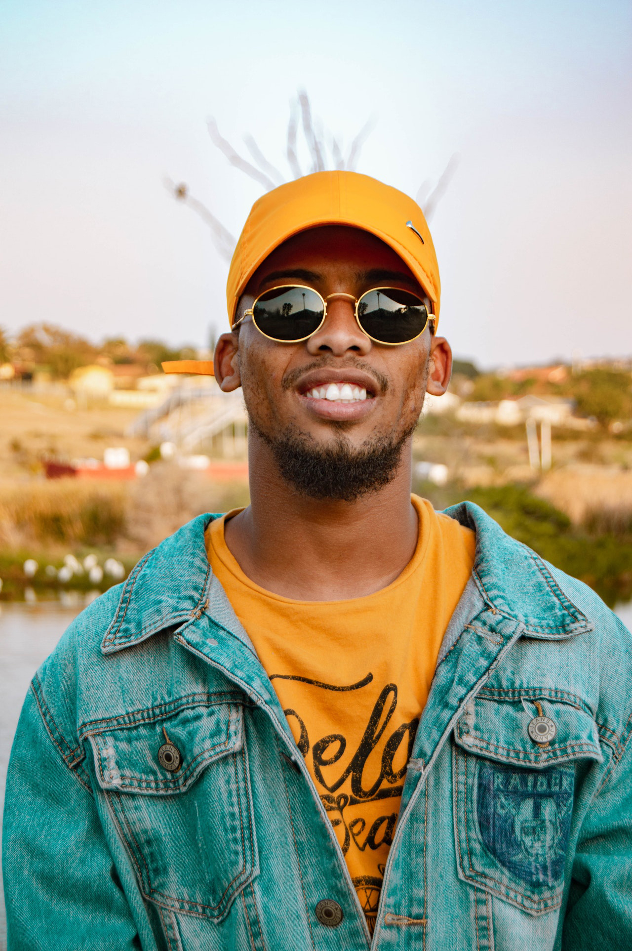 man-in-denim-jacket-yellow-cap-and-sunglasses-Photo by Keanen Geego Kilian from Pexels